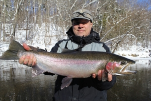 Ron, from SE Michigan, with a beautiful Muskegon River, male Steelhead.